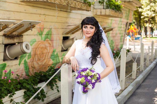 Практичное,красивое свадебное платье .