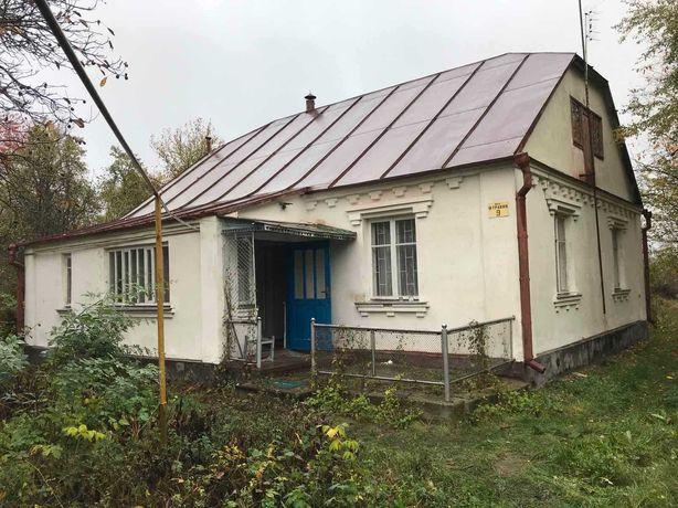 Дом и подсобные постройки с участком