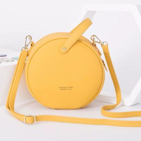 Круглая сумка через плечо