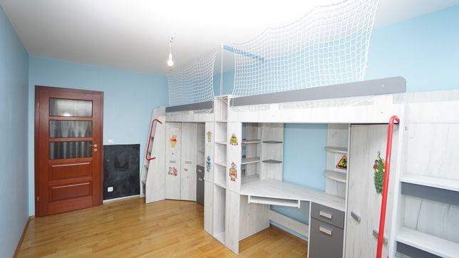 Dwa łóżka biurko szafy prawe i lewe