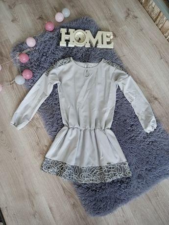 Sukienki dla dziewczynki rozm.146