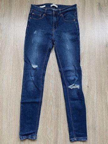 Niebieskie spodnie dżinsowe z dziurami Pull&Bear rozm. 38 (M)
