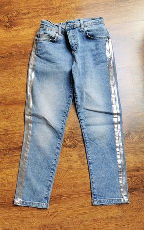 Jeansy dżinsy dziecięce Mohito 134