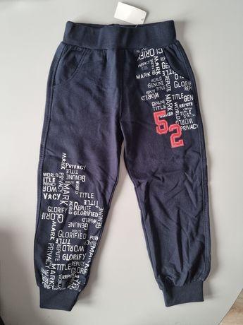 Nowe spodnie dresowe 104