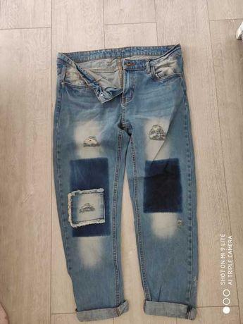 spodni z łatami jeansowe