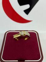 Złoty pierścionek 18k z brylantem 0.15ct