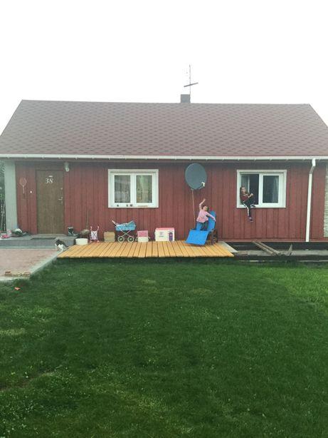 Dom drewniany do wynajęcia z dużą działką