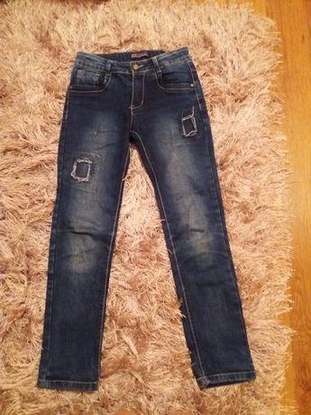 Spodnie jeansy 134-140