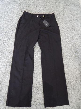 Nowe proste eleganckie spodnie 44