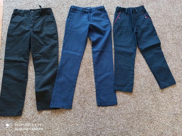 Eleganckie spodnie chłopięce 116 i 2 pary 128 Bdb
