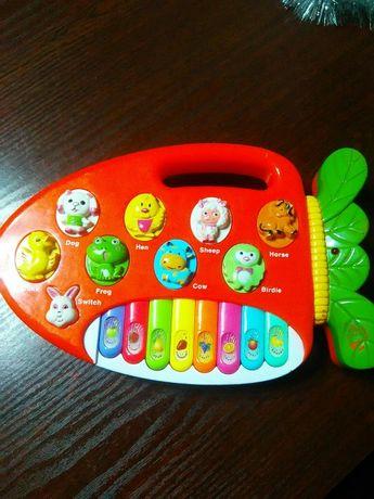 Продам музыкальную игрушку