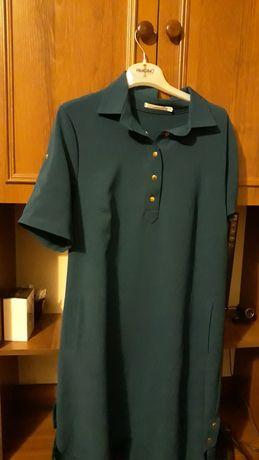 Плаття приємного зеленого кольору, плотненький матеріал
