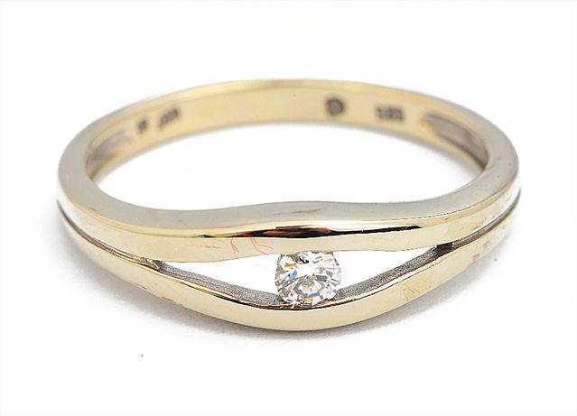 Złoty pierścionek z brylantem pr.585 roz.9