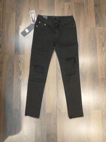 Nowe damskie spodnie jeans rozmiar 38 M z dziurami.