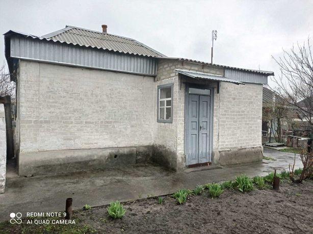 Продам дом с участком земли в г. Лиман