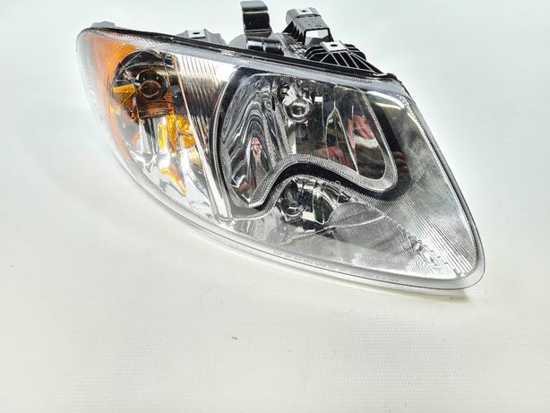 Chrysler VOYAGER 00-04 reflektor lampa prawa przód HB5 OEM USA