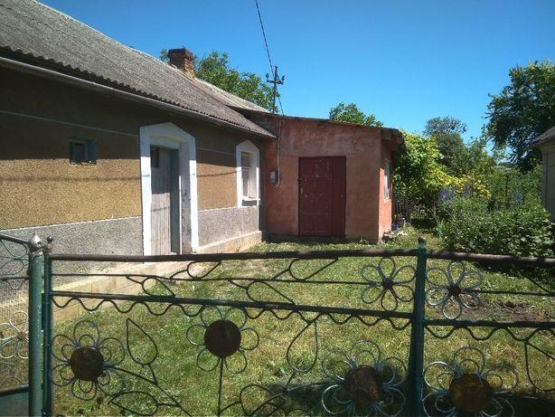 Земельна ділянка з домом