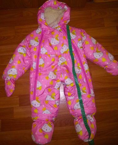Продам зимний комбинезон для новорожденной девочки