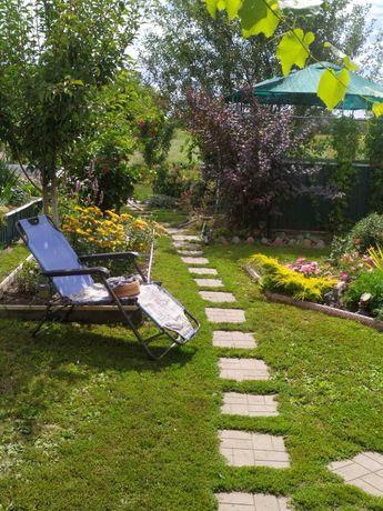Продаеться дом 170 квадратных м.  с большим участком и шикарным садом