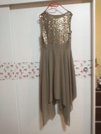 Sprzedam sukienkę stan bardzo dobry złota rozmiar 42 założona raz.