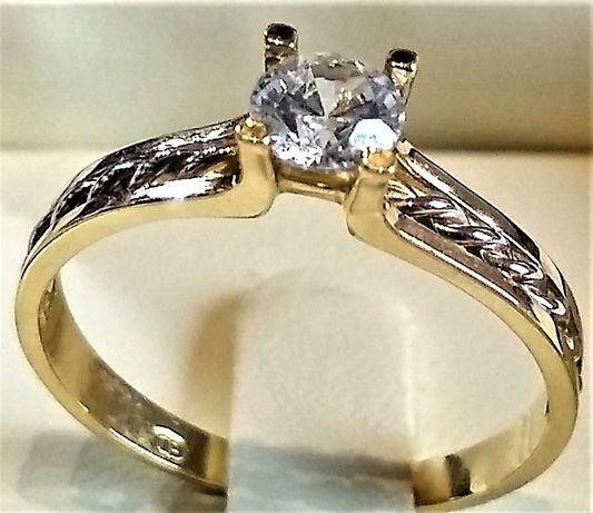 Złoty pierścionek z brylantem 0,38ct . 585 pr.