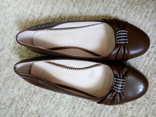 Подарую туфлі майже нові