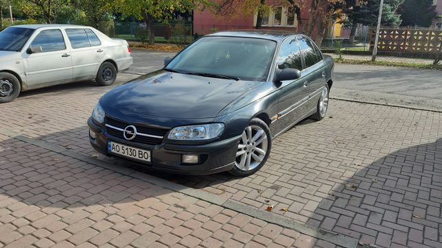 Opel Omega B X20XEV ГАЗ КОЖА