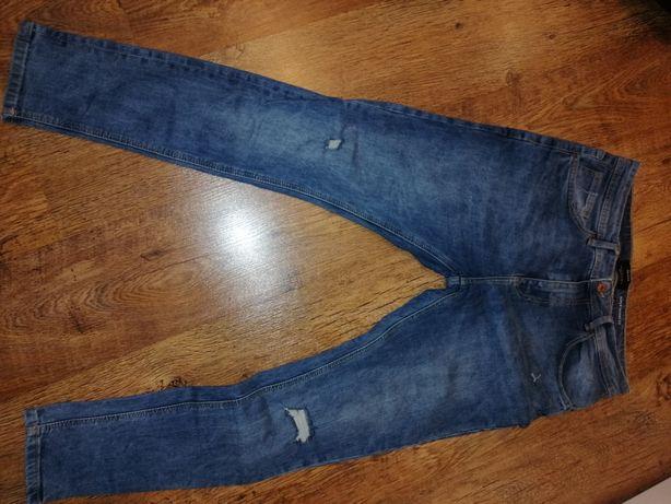 Spodnie jeans 44