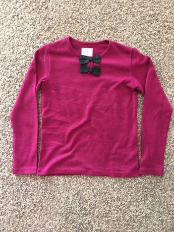 Ciemno różowy sweterek z kokardami