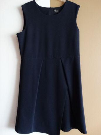 Sprzedam sukienkę wizytową dla dziewczynki w rozmiarze 158 firmy SLY.