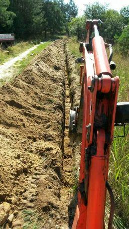 Uslugi minikoparka , koparka wołów, wykop, fundamenty, kable woda prad