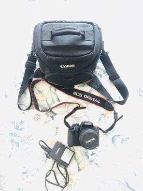Maquina Canon E05 1000D + saco