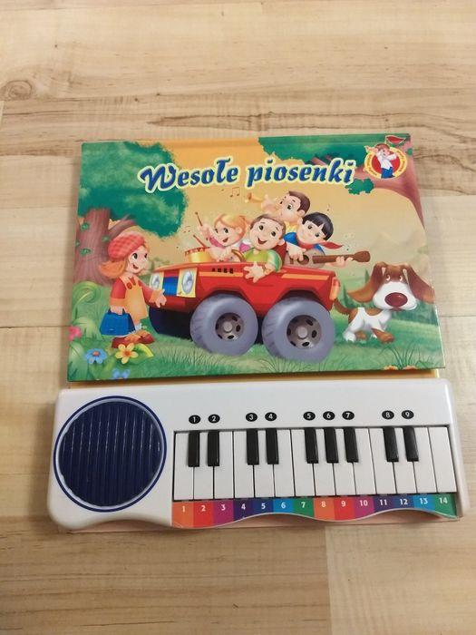 Książeczka z pianinkiem Wesołe piosenki Piła - image 1