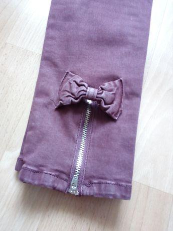 Nowe spodnie z kokardkami 38