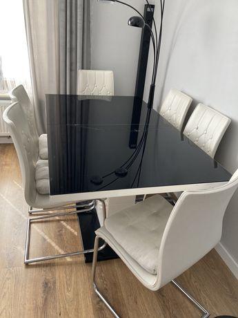 Stół szklany rozkładany z krzesłami ze skóry