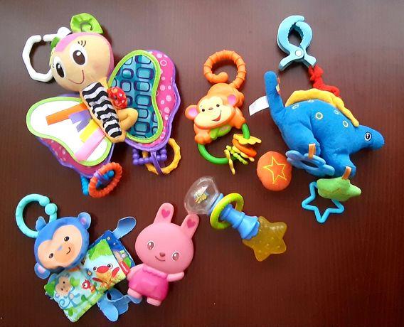 Zabawki zawieszki grzechotki gryzaczki