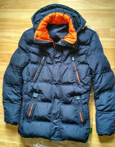 Продам теплую стеганую куртку на подростка лет 15-16.