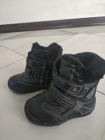 Нові, шкіряні чобітки