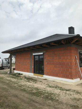 Dom z garażem w stanie deweloperskim (kalcyt]