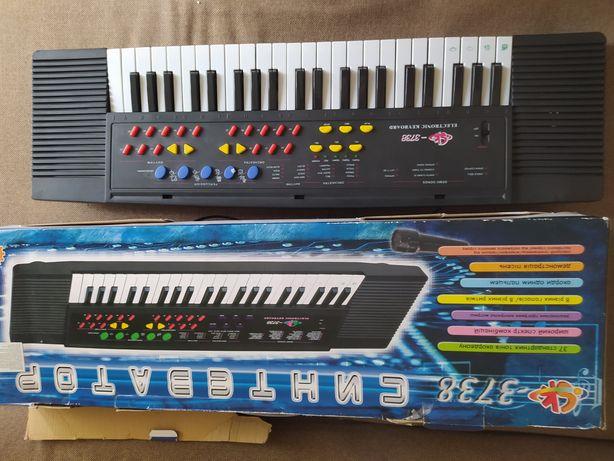 Синтезатор детский (игрушка)