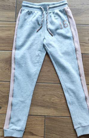 Nowe dziewczęce spodnie dresowe, rozmiar 134