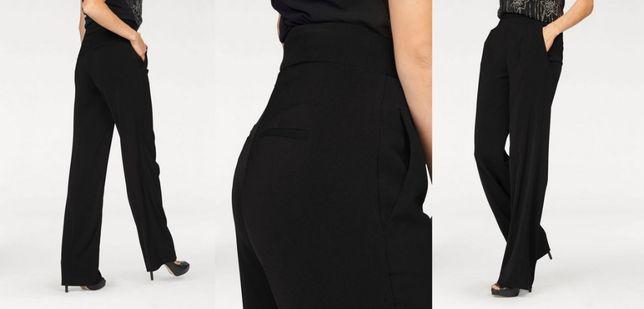 Nowe czarne eleganckie spodnie wysoki stan marki Laura Scott R. L - 40