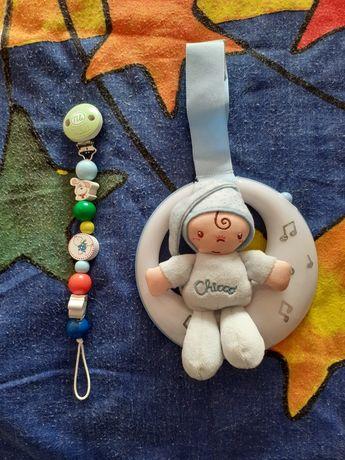 Brinquedo bebe + prende chupeta