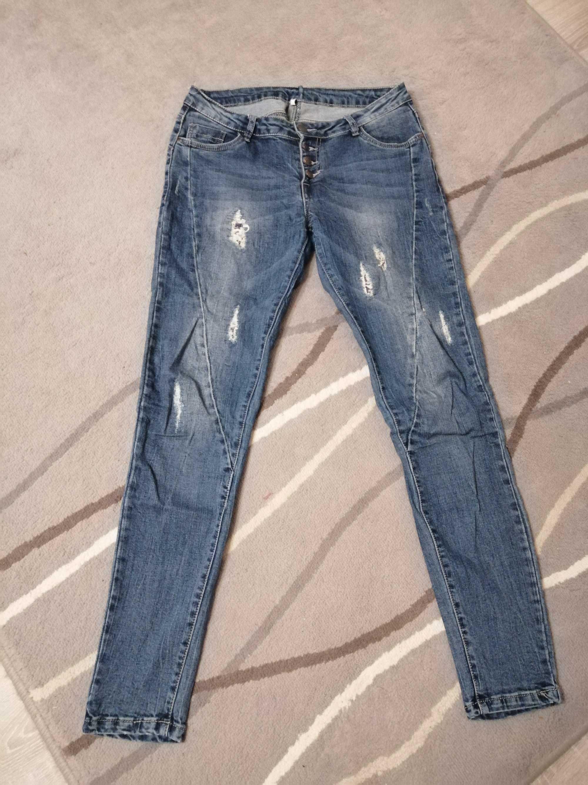 Spodnie jeansy z przetarciami zapinane na guziki 40 L