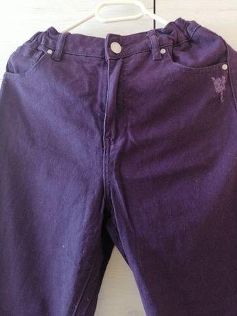 Fioletowe jeansy damskie z gumką w pasie rozmiar 36 marki Reserved