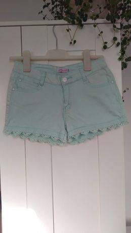 krótkie damskie spodnie z koronkowymi kieszeniami rozmiar 34