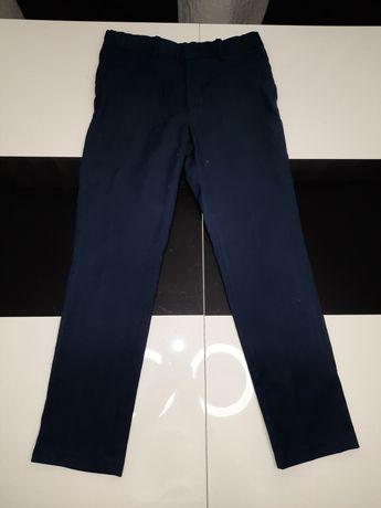 Eleganckie spodnie granatowe rozmiar 140cm. Okazja!!!