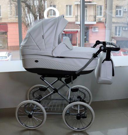 Классическая коляска на 14' колесах Roan Emma белая эко-кожа