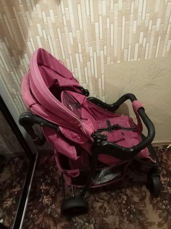 Детская коляска розовая
