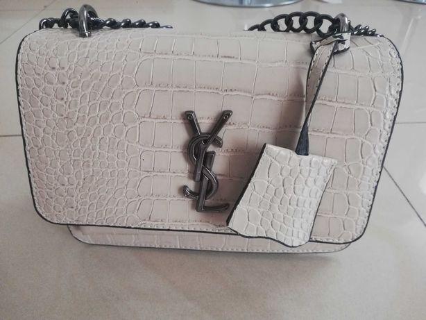 Nowa beżowa torebka Yves Saint Laurent.